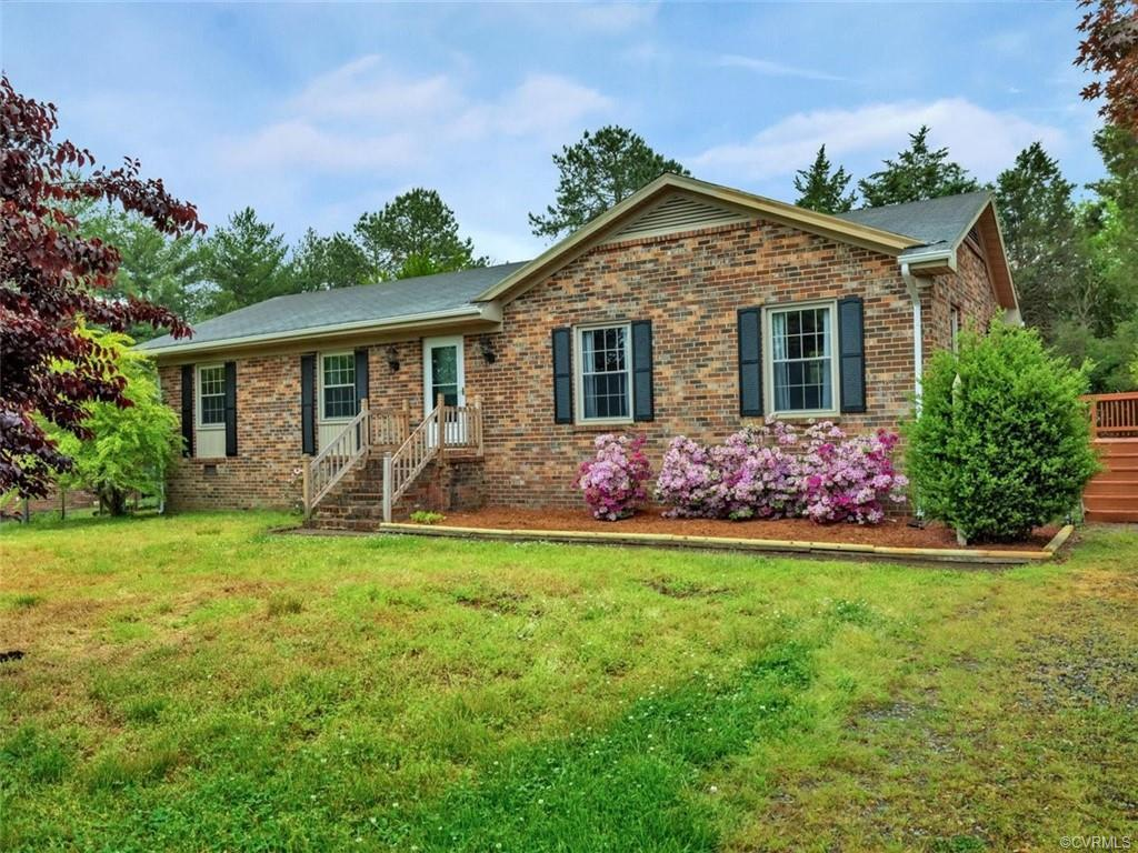 Welcome home to this move-in ready Henrico County brick rancher in an established and desirable neig