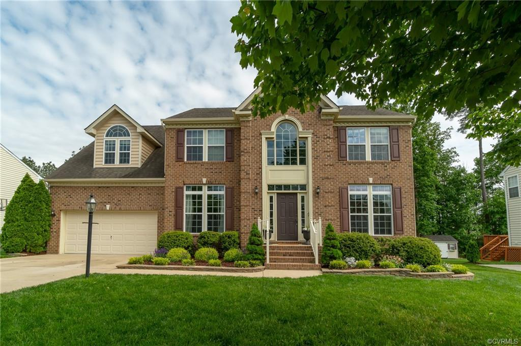 Welcome home; open the front door to tons of natural light pouring in your 2 story foyer! There is a