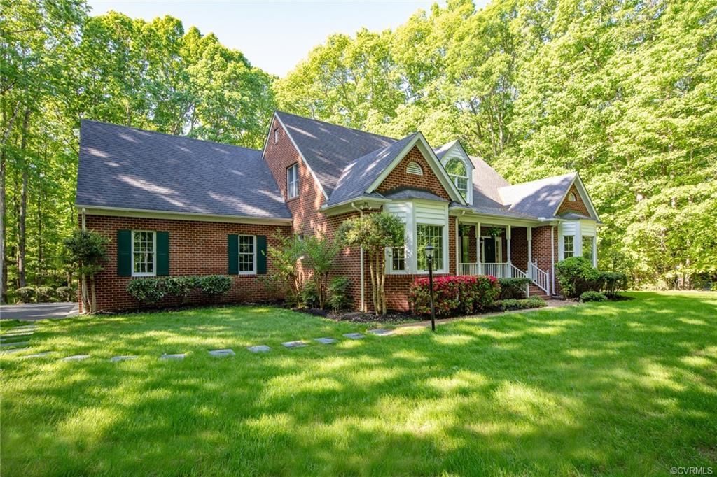 Located in the small, cul-de-sac community of Hunters Woods, this all brick home with its 3.45 acres