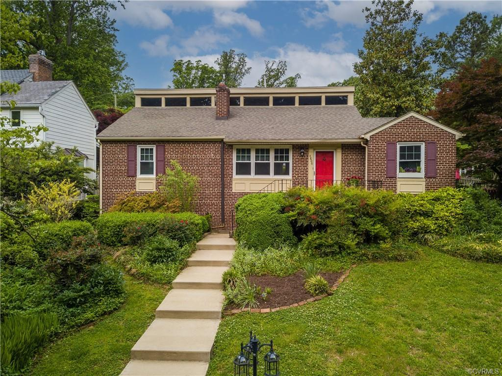 Nestled on a hill overlooking James River Parks and the mighty James River sits this unique brick ca
