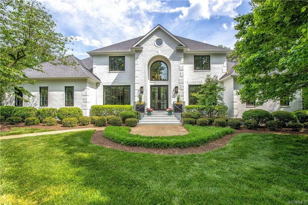 Elegant 5100 sf home in the tranquil River Road corridor. Exquisitely landscaped 1 acre setting with