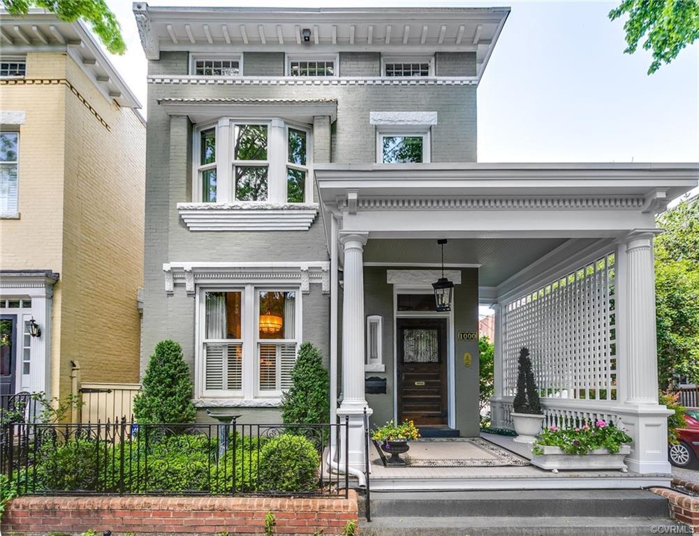 Character abounds in this exceptional 1894 brick Fan residence, which is one of the original homes b