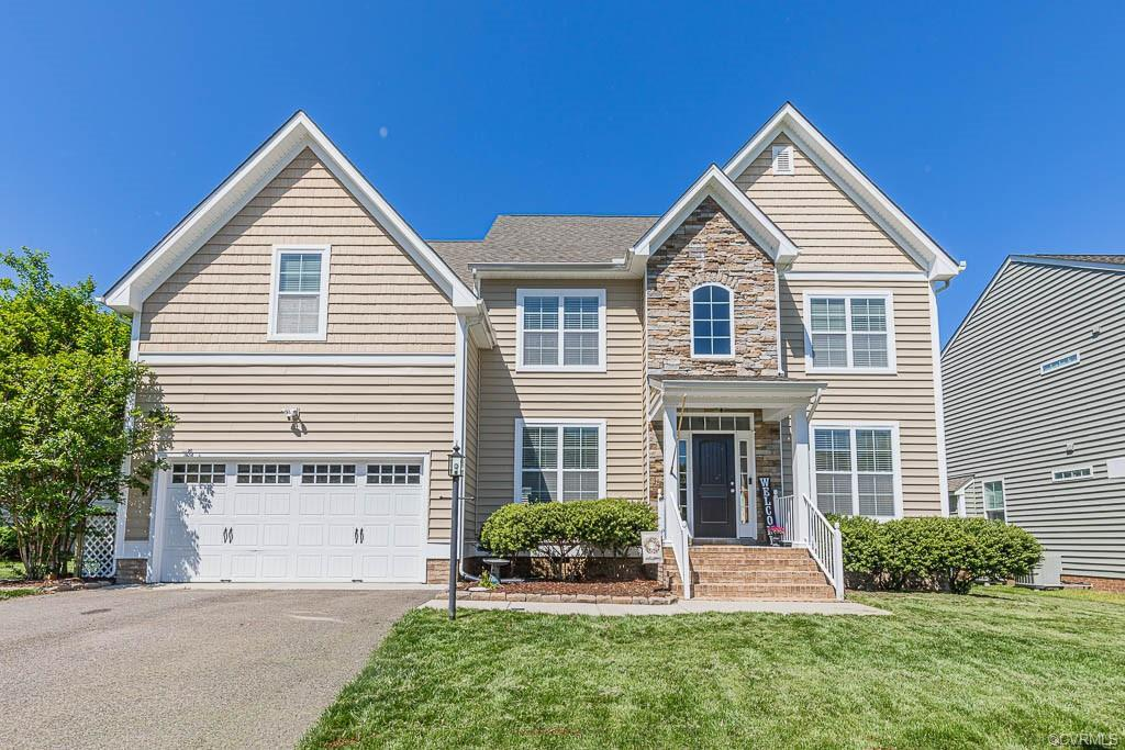 Welcome to 9055 Sutlers Ln in The Bluffs at Bell Creek! HANOVER HIGH DISTRICT! This 4,039 sq ft, 3 l