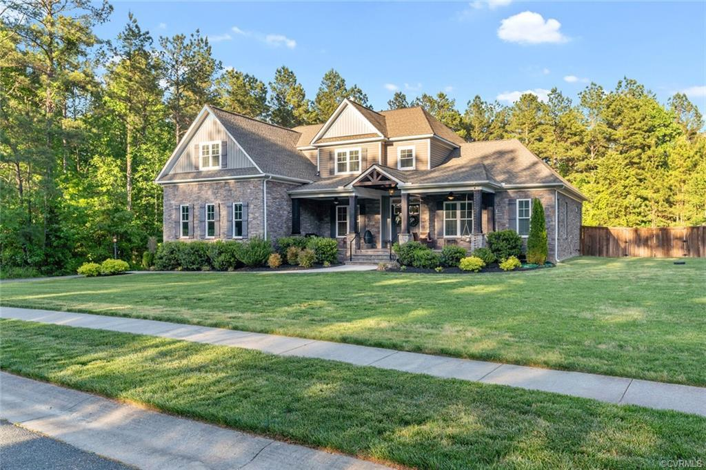 WOW! This stunning craftsman style home has it all. This custom-builder designed home has been built