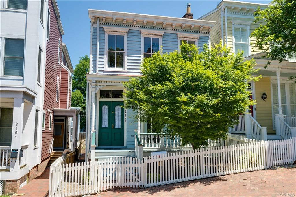 Located in Richmond's Church Hill, this historic three bedroom / two and a half bathroom row house b