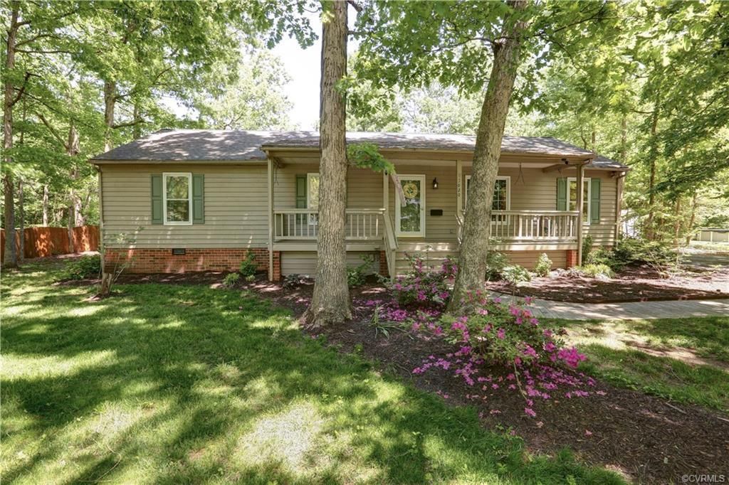 Looking for peaceful, farmhouse living on nearly ½ an acre on a GORGEOUSLY landscaped lot? 3020 Quai