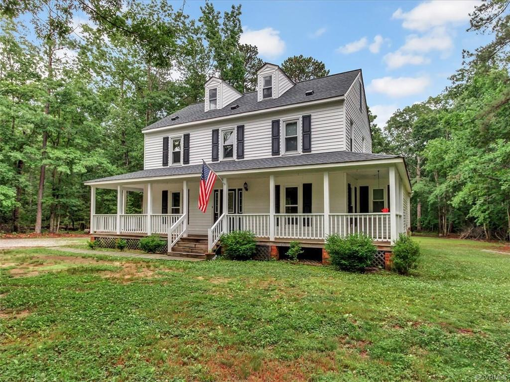 Gorgeous traditional style home boasting over 2,700 SqFt and 5 bedrooms and 2.5 baths sitting on ove