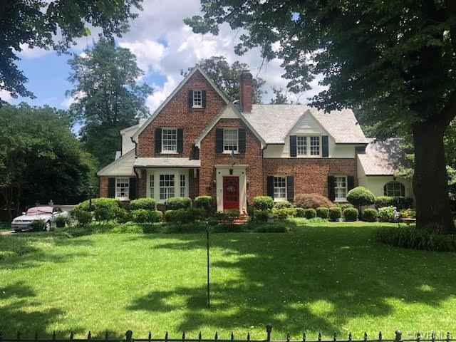 With its richly detailed front elevation and manicured, nearly ½-acre landscape, this brick-and-slate Colonial Revival in sought-after Ginter Park personifies elegance. And the rich architectural details continue inside, with arched doorways leading into the formal living and dining rooms. The living room has a fireplace and built-ins, and the dining room has a bay window with built-in seating. The first level also has a mud room, a sun room and a breakfast room off the renovated kitchen, which has white, raised-panel cabinets, stone counters, a stainless appliance collection, a stainless sink and a tile backsplash. The second level features three bedrooms, including a master with its own bath. (A fourth bedroom has been converted into a large walk-in closet.) The backyard, which has been fenced for privacy, is a showcase for outdoor living, with a swimming pool, a cabana and a multilevel deck. Just move in and relax in elegance!