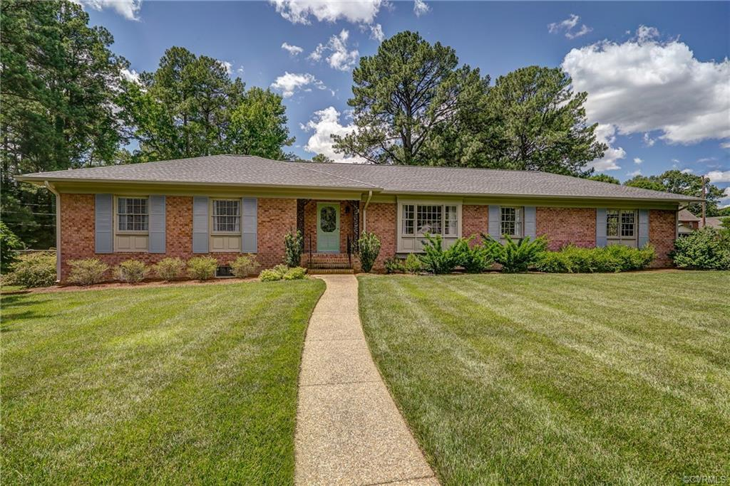 This hipped-roof, brick Ranch offers something a lot of buyers want these days: the ease of first-floor living. And it pulls it off with sleek style, mixing traditional details with a touch of Midcentury cool. Set on a well-manicured, nearly ½-acre lot, the house offers more than 2,000 square feet of freshly painted living space, including formal living and dining rooms, a family room with a fireplace and an updated kitchen with painted, raised-panel cabinets, a double stainless sink and a new stovetop and hood. Rounding out the floorplan: a hall bath and three bedrooms, including a master bedroom with its own bath. Plus, a bonus: The lower level of the house has an additional 2,000 square feet of multipurpose space. Two car garage. Wood floors; new HVAC. The large backyard, fenced for privacy, has a deck, a large herb and vegetable garden and plenty of room to entertain. Just move in and invite your friends and family to an outdoor party!