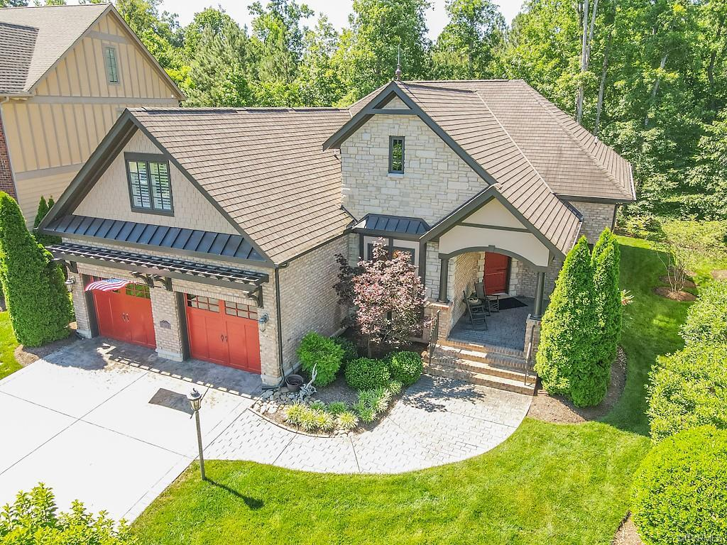 """ONE story custom built home situated on one of the most private lots in the sought after community of Bel Bridge. A former Parade of Homes winner features spacious foyer leading to formal rooms & Chef's kitchen w/13'5""""x8'7"""" eat-in area.  Off kitchen is a vaulted family room leading to screen porch & 18'6""""x 13'2"""" stamped patio w/stone wall.  Primary suite features gas fp, 2 walk-in closets & luxury bath w/soaking tub, oversize shower & custom design double vanities.  There is also a guest suite w/private bath & large study that can be additional bedroom.  Up is a perfect retreat for guests & also includes conditioned storage & walk-in attic.  Other features are wide plank distressed flooring throughout 1st floor w/tile in baths & laundry, intricate 9+ & vaulted ceilings w/trays, custom moldings & bead board, gourmet kitchen w/abundance of custom cabinetry & granite w/breakfast bar & GE Profile appliances, custom lighting & fans throughout, built-in cabinetry laundry & family, security, surround sound, oversize 2 car finished garage w/specialty painted floor, plantation shutters, large front porch.  Low maintenance vacation living w/yard maintenance, window washing, etc. provided!"""