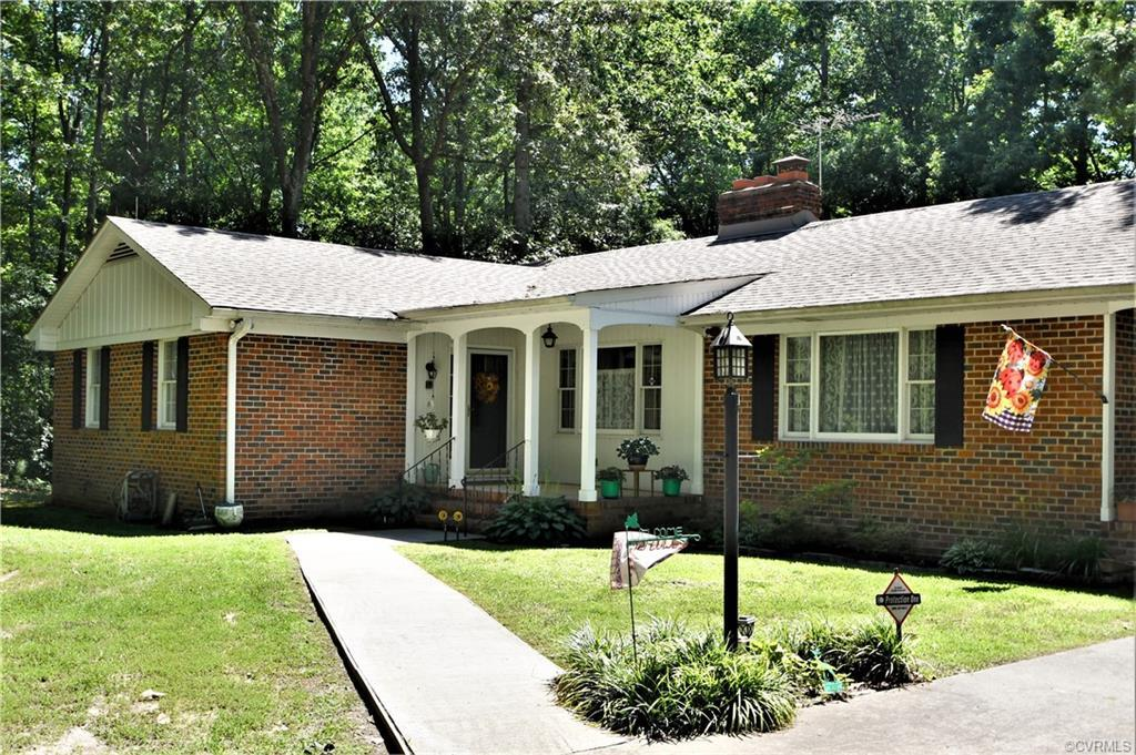 Lovely brick rancher with a full unfinished basement just waiting for your finishing desires.  Located on 6+ private and serene acres including a spring filled and stocked pond.  Thinking horses in your future, the barn and fencing is already there!  This home features updates thru-out with a newer roof, gutters and skylights, newer water heater, new heat pump in 2016 and lovingly maintained.  There are 2 fireplaces one wood burning in the Living Room and a gas fireplace in the Family Room.  There is a whole house generator, newer windows, water purification system and so much more.  The basement does feature the perfect spot to wash and groom your dog, the back deck is the perfect spot to sit back, relax and survey your property.  Want to get away, we have found your spot, just stop by and take a look.