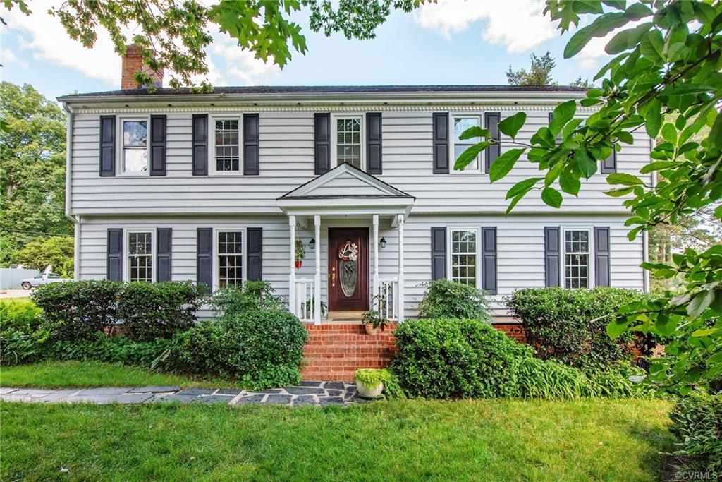 """Great opportunity in the highly sought after Shenandoah neighborhood! Gorgeous 2-Story Colonial with First & Second Floor Primary Bedrooms! First floor Primary Bedroom w/attached full bath is handicapped equipped and can be entered either from inside the home or outside. Would make a great in-law or teen suite. Large living room (currently used as dining room as sellers love to entertain!). Large updated eat-in kitchen. Dining room (currently used as home office) has French Doors to a covered deck...another great entertaining area!! Family room with brick fireplace and wood stove, and pass-thru bar to kitchen. Wrap around staircase with landing leads to the second floor that also has a primary bedroom with attached bath, and 3 additional nicely sized bedrooms up. The attached garage has roll-up doors on the front & back! Huge """"man cave"""" workshop in the backyard with electricity & air conditioning. Walk to the community pool, tennis courts, playground & clubhouse (membership required, but sellers have a discount certificate for the next owner!!). Very convenient to Powhite Pkwy and Downtown, MCV/VCU."""