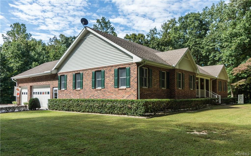Amazing property on 5+ acres with multiple buildings!  The all brick MAIN HOUSE includes 4 BRs, 2 1/