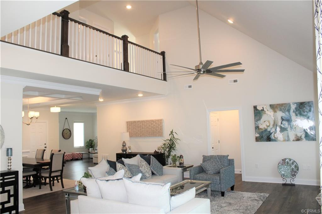 Meet the Milan. This first floor primary owner's suite home offers a breathtaking two-story family r