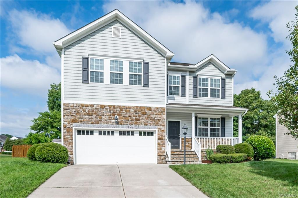 Welcome home to The Bluffs at Bell Creek! This 2 story, craftsman style boasts an open concept & has