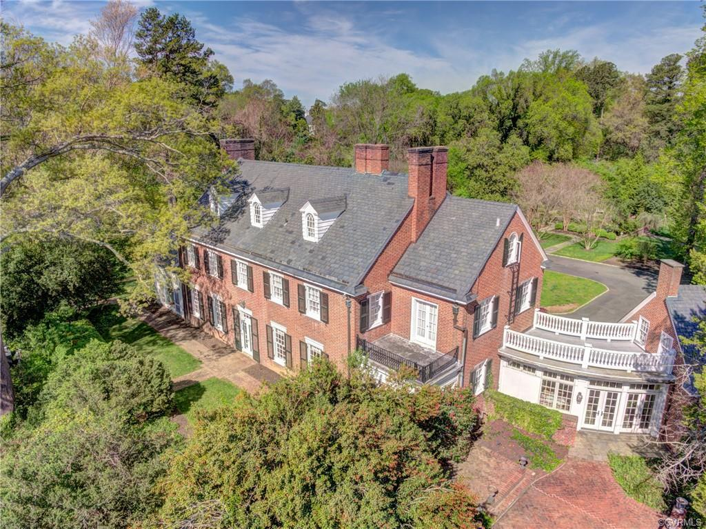 Magnificent Georgian brick and slate mansion, circa 1900 set on 5.4 acres on a hilltop above the Jam