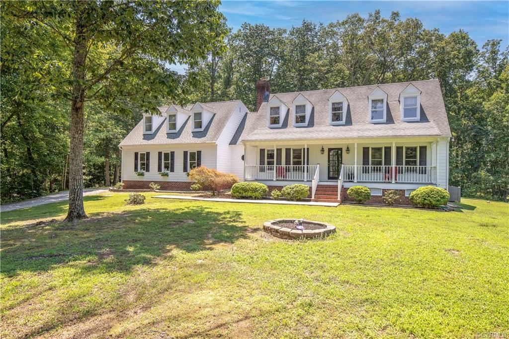 You will absolutely LOVE the convenience of this terrific home situated on over 2 acres just across