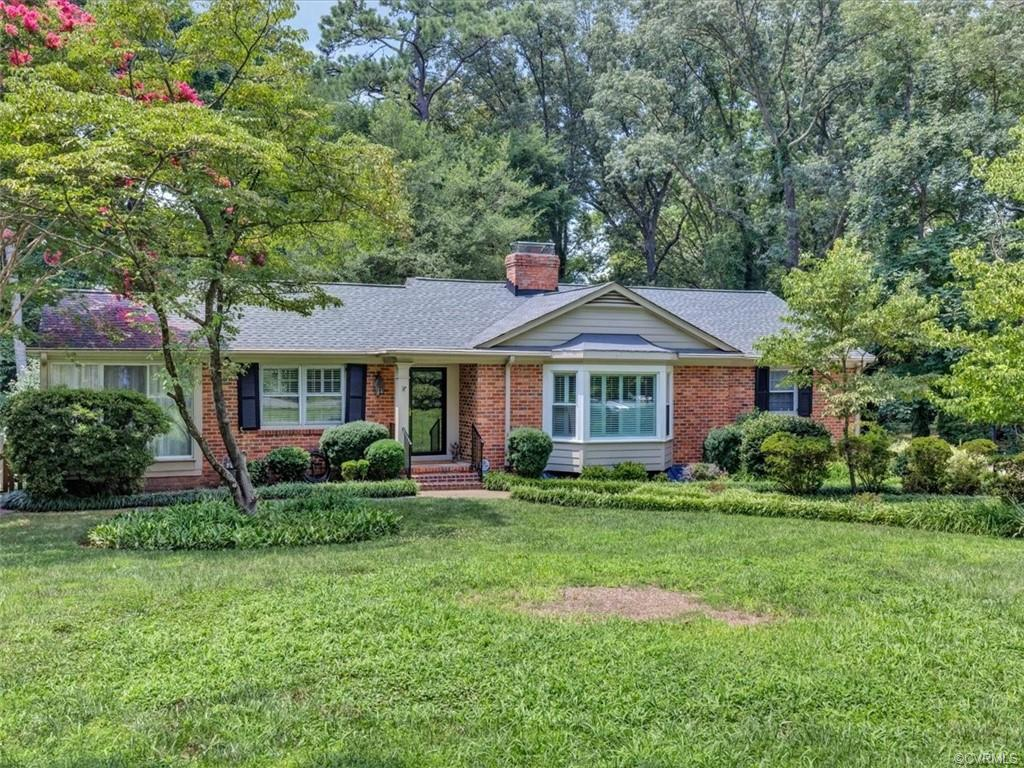 Welcome Home! This lovingly maintained raised rambler greats you with lush landscaping and tons of c