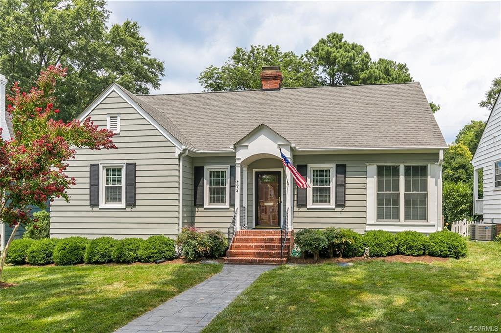 Located on a premier block in RVA's West End, this storybook home features classic hardwood floors,