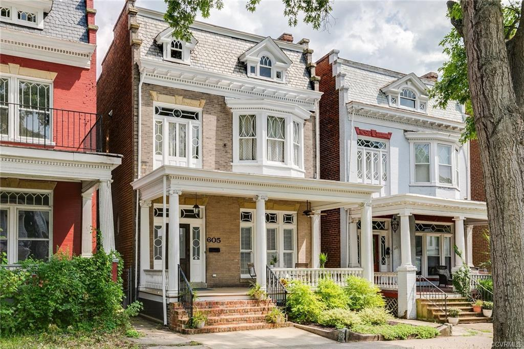This handsome Church Hill home retains many original details such as stunning windows restored with