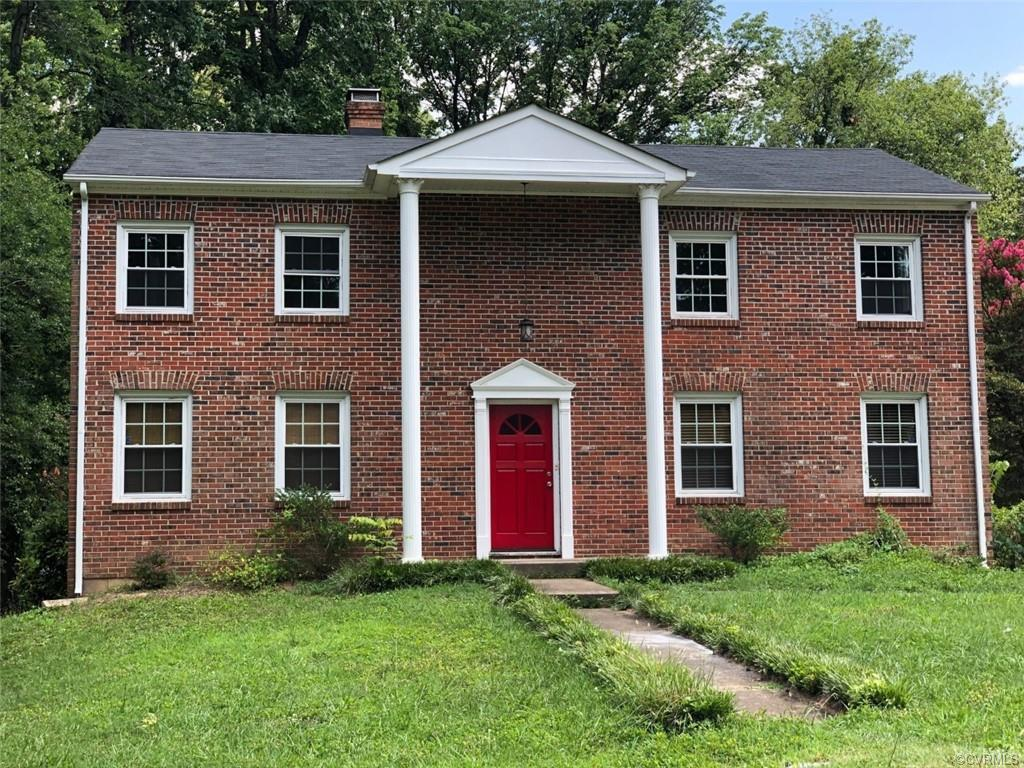 Gorgeous brick 4 bedroom, 2.5 bath home on a large corner lot in April Acres with a rear deck ideal