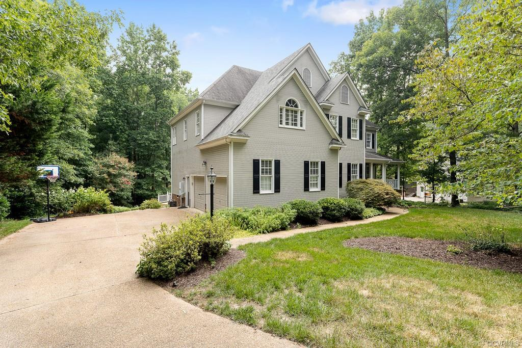 Back on the Market!  This transitional sits on a beautifully landscaped lot in the stately subdivisi