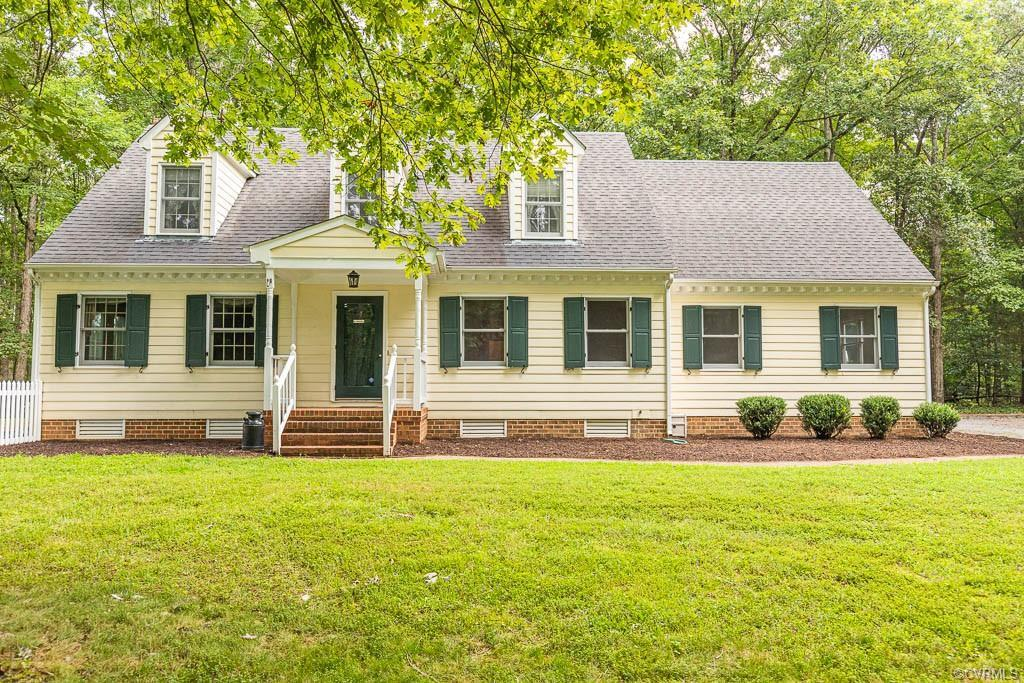 Enjoy this Cozy Cape on 3.95 Acres located on one of the prettiest roads in Hanover County and only
