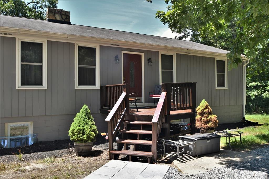 Head on out to Beaverdam, VA where friendly neighbors, local festivals and peace and quiet are the norm!  A rancher with a basement on 5+ acres awaits your arrival.  This home has been transformed in the past 2 years.  Upstairs features all new wood floors and tile flooring, an undated kitchen with beautiful wood cabinets and granite counter tops, the stainless steel appliances convey.  Let's not forget the all new bathrooms too!  Enjoy cool evenings on the deck or bring the party to the sunroom with a vaulted ceiling.  The basement could be an excellent spot for a private suite, there is a bedroom with a full bath attached and a family room.  There is plenty of storage and 2 flex rooms  in the basement for either more storage or finish for your project room.  Need a garage, we have that too!  Updated lighting thru-out most of the home, recessed lighting in the kitchen, Ceiling Fans in the bedrooms, family room and sunroom.