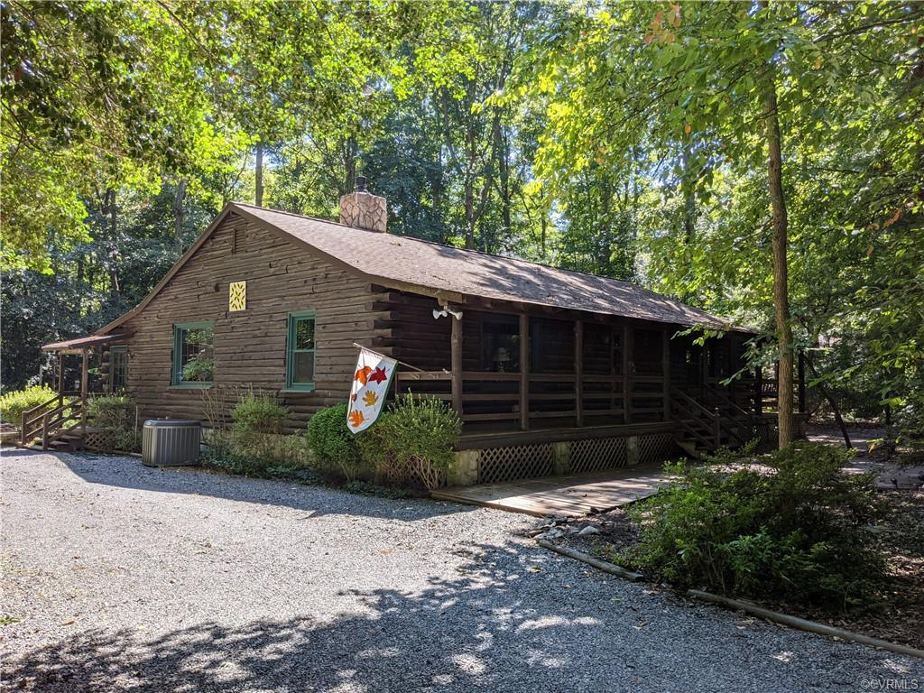 Welcome home to 11413 Mill Road! This charming log home is nestled on a wooded acre-plus lot - all t