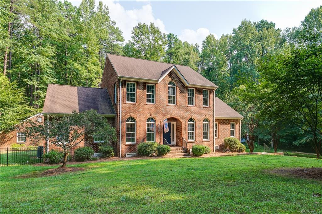 Privacy abounds with this beautiful well-maintained Custom Brick Colonial which has many renovations