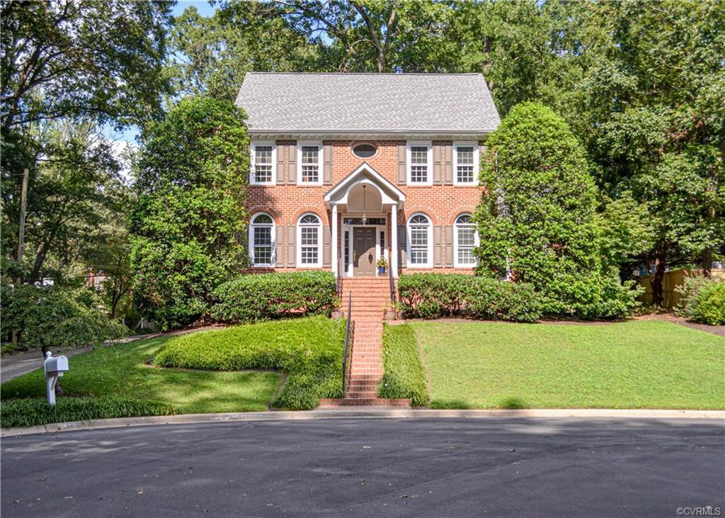 Built in 1990 by renowned Richmond builder, Mike Dumont, this all-brick stately home is located at t