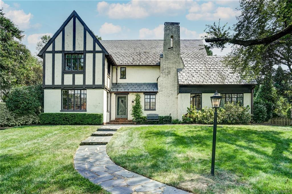Welcome to 11 Roslyn Road, a classic 1925 Tudor Revival located in highly sought after Hampton Garde