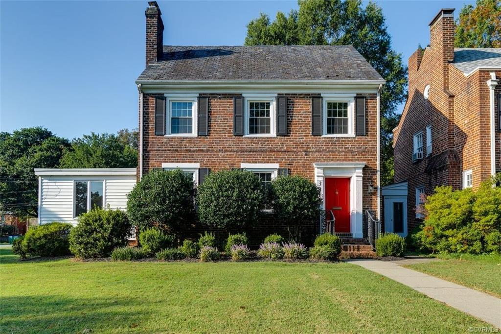 This classic two-story brick and slate Colonial rests in the heart of Malvern Gardens, within walkin