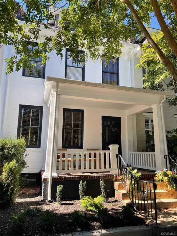 Looking for just the right spot in the Fan? This stunning white brick rowhouse with contrasting blac