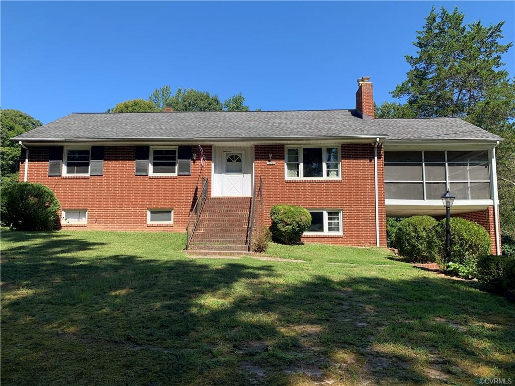 3 bedroom, 3 bath brick home situated on a 10.78 acre lot with hardwood floors, 2 wood burning firep