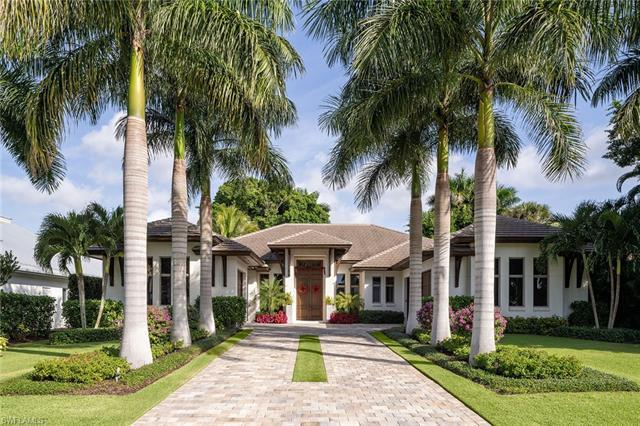 In a coveted west of Crayton Road location, this Moorings home was designed by Falcon Design and bui