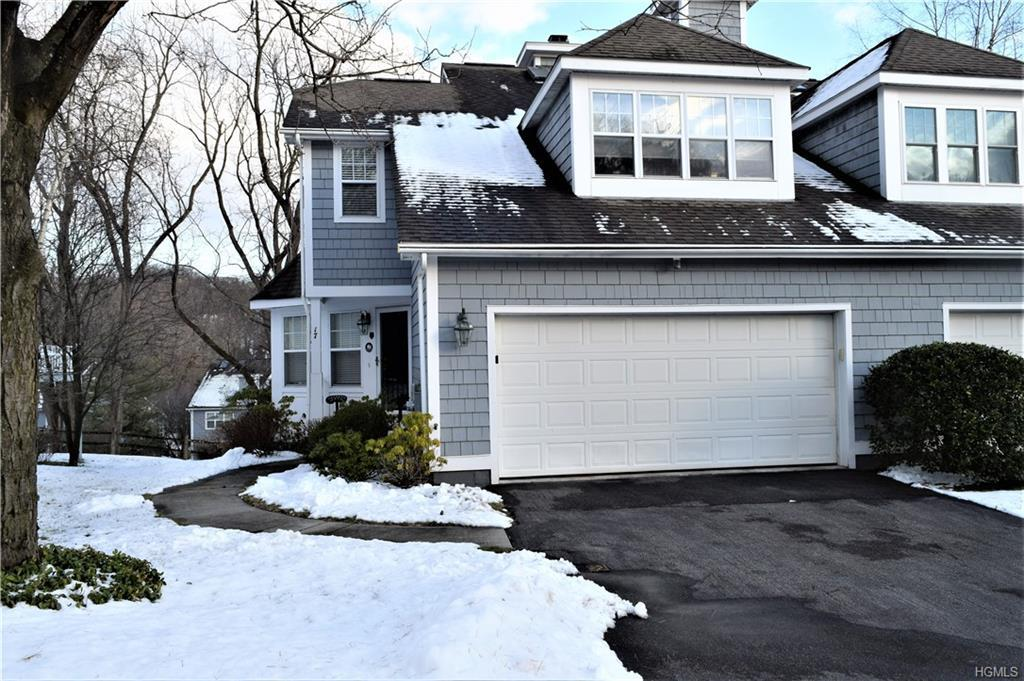 Luxury tri-level townhouse with attached two car garage in upscale Mystic Pointe.  Contemporary kitc