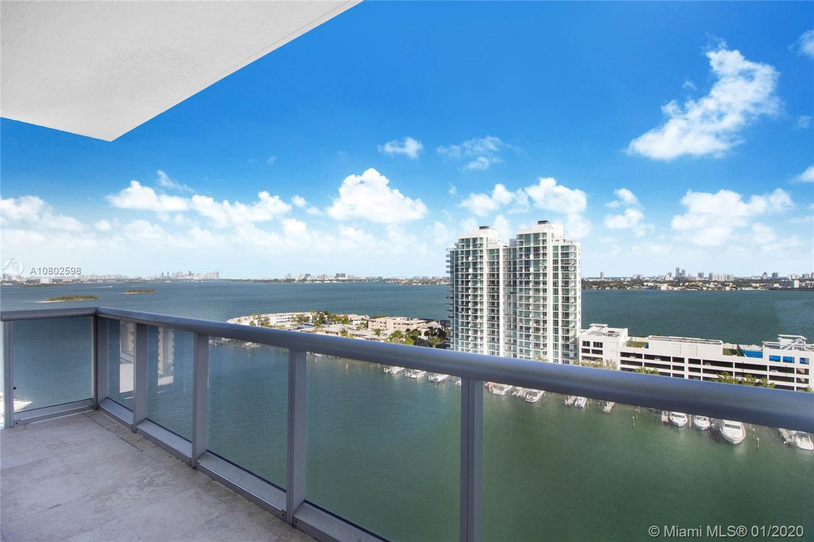 Penthouse corner flow-through unit with 10 foot ceilings and incredible ocean, bay and downtown skyl