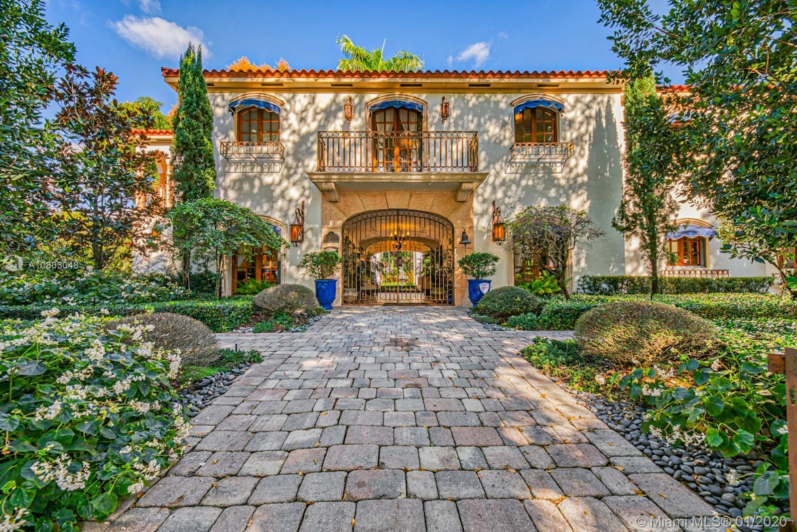 Breathtaking Coral Gables estate on rare double lot situated on a quiet tree-lined street walking di